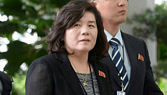 North Korean official heads for talks...