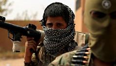 Kurd-led forces overruns last IS-held village in Syria