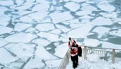 At least 12 dead as polar vortex spreads...