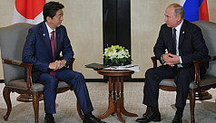 Putin, Abe hold summit to break island...