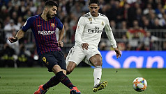 Suarez double downs Madrid to send Barca...