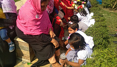 Children wash mothers' feet to mark Valentine's Day in Tangail