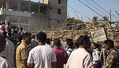 Two dead, dozens trapped, in India building...