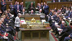 May fights for survival as parliament...