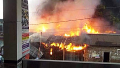 Fire guts over 50 shops in...