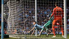 City back on top after tense win over...