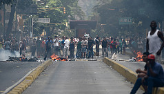 Venezuelans set up burning barricades...