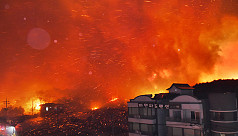 Thousands flee wildfire in South Korea's...