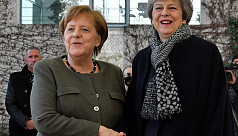 PM May seeks Brexit delay from Merkel,...