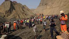 Rescuers battle to find dozens killed...