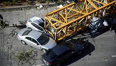 Crane collapse kills four, injures three...