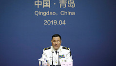 China to show new warships as Beijing...