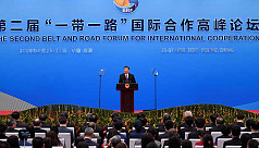 Xi says to reject protectionism, open...