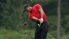 Woods wins Masters to end 11-year major...