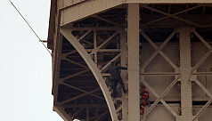 Eiffel Tower closed down after climber...