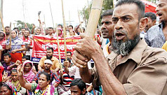 Jute mill workers continue protest in...