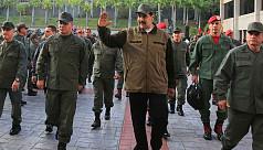 Maduro hangs on as Venezuelan protests...
