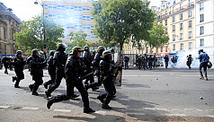 French police fire tear gas at protesters...