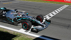 Hamilton back on top with victory in...