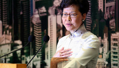 Hong Kong leader apologizes as rally...
