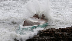Capsized lifeboat leaves three dead...