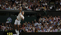 Federer holds off Nadal to reach Wimbledon...