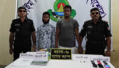 Two suspected militants arrested in...
