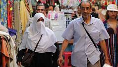 Tunisian PM bans face veils in public...