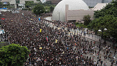 Hong Kong protesters march on station...