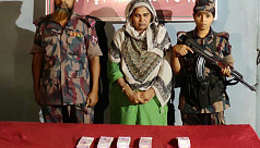 Woman held with foreign currencies at...