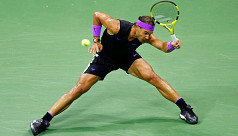Nadal into semis after big fight from...