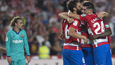 Granada stun Barca to go top of La...