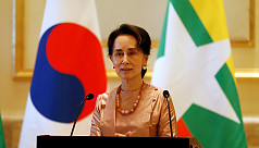 High stakes: Suu Kyi gambles image in...