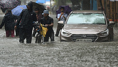 Heavy rains cause commuter chaos in Mumbai