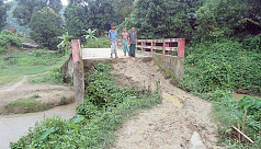 Deformed bridge-road in Lama, Bandarban leave villagers in trouble