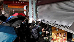 Hong Kong firms, lacking riot insurance,...