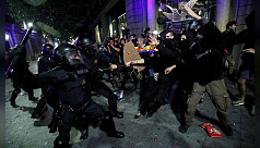 Police, Catalan separatists clash as...