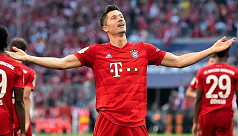 Lewandowski makes history again as Bayern...