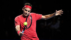 Federer brushes De Minaur aside to claim...