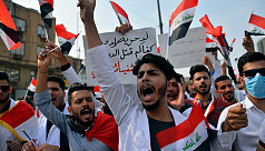 Students flood Iraq streets, defying government, parents