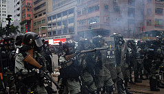 Police fire tear gas as large crowds...