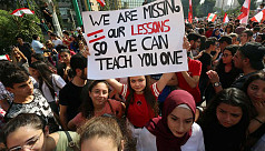 Lebanese banks, schools shut as protesters...