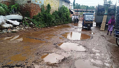 Commuters in Madaripur Sadar struggle with potholed road