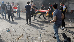 Iraq protests ramp up, shutting roads, offices and schools