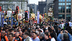 Tens of thousands celebrate Japan emperor's...