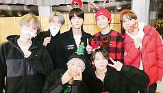 K-Pop fans brave Seoul's Christmas chill to buy BTS 'merch'
