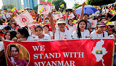Loyalists rally for Suu Kyi before genocide trial