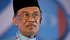 Malaysia's ruling party makes fresh push for Anwar to take over as PM