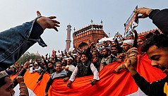Indian Muslims wave national flag to...