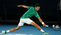 Djokovic sets up Federer showdown with...